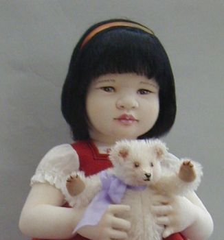 Asian girl with teddy by clothchick