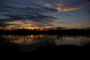 Sunset over the lake by pixlepixie