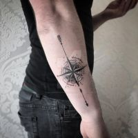 Abstract compass and arrow tattoo by SelfmadeTattooBerlin