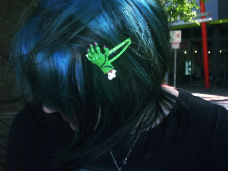 Blue hair and a zombie hand. by myheartindollparts