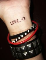 to write L.O.V.E. on her arms. by frostedxtears