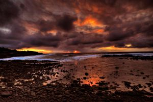 Kauai Sunrise on the Rocks by cmetzguer