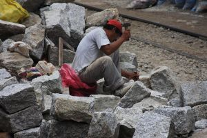 Railroad Worker Breaking Rocks by StewartSteve