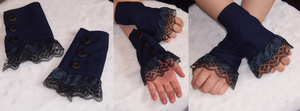Blue wrist cuffs by AcrotomicStudios