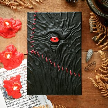 Red eye and stitches necronomicon by MilleCuirs