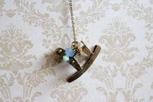 Rocking Horse Necklace by YourSweetTreat