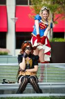 Supergirl and Batgirl: Teasing is Fun! by OscarC-Photography
