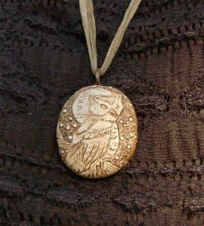 Embossed Owl Necklace by jemnisimi
