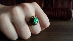 Steampunk ring with green harlequin glass by CatherinetteRings