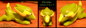 Electrike mini figure sculpture