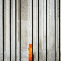 Concrete Barcode With Orange Tape by Pierre-Lagarde