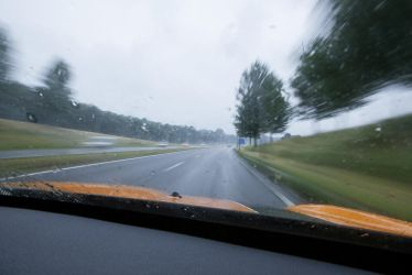 Highway chase speed rainy day by ISOStock