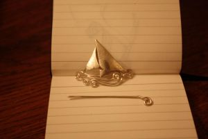 Silver ship brooch ii by entanglement