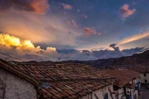 roofs on fire in cusco by valentinous