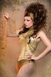 gold woman by TheComtesseLea