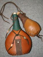 Leather covered bottles by Laerad