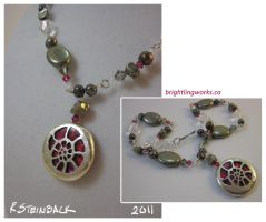 Silver-Wrapped Paua Ammonite Necklace by brightling