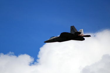 Cutting Clouds, F-22 Flyby. by BTedge116