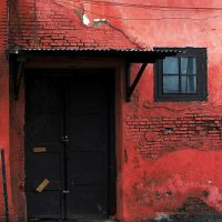 red wall and black door by imajiku