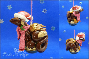 Christmas Griffin on the bell - hanging sculpture by CalicoGriffin