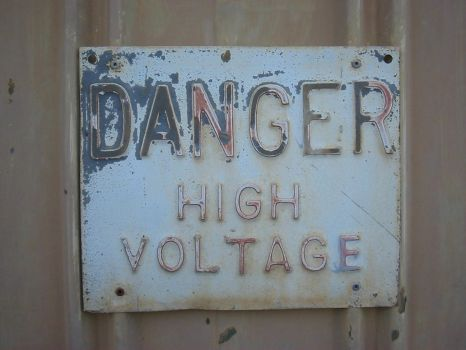 Danger High Voltage Sign - old by kayne-stock