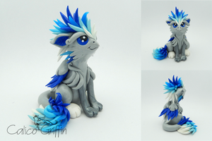 Kori the ice griffin - polymer clay sculpture by CalicoGriffin