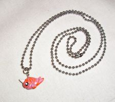 Pink and Orange Narwhal Necklace by happysquidmuffin