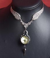 winged pocket watch pendant by Pinkabsinthe