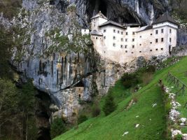 Predjama castle with cave by ahotko
