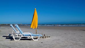 Sun Umbrella and Chairs on the Beach by TomFawls