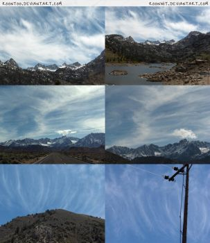 Wispy clouds over mountains by RoonToo