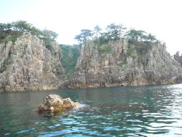 Cliffs from Boat by katters