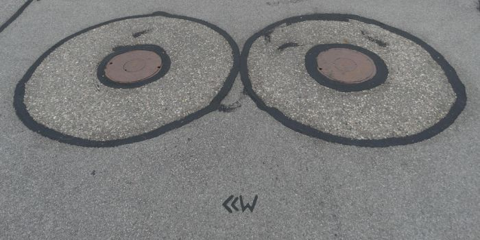 Twin Sewer Covers by Crigger