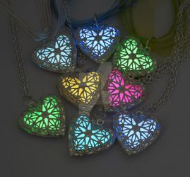 Glowing Heart Necklaces 2015 by ArchandSoul