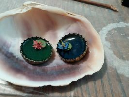 Waterlily Resin-cast bottlecap charms by ShadyDarkGirl