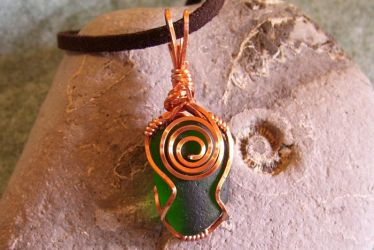 Wire-wrapped sea glass pendant by Swirlything