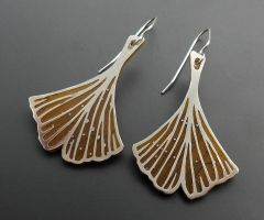 Gold and silver Ginkgo leaf earrings by thebluekraken