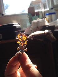 Goldfish pendant letting in the light by SunreiCreations