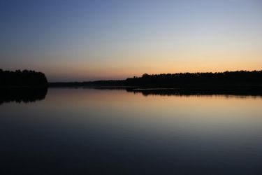 Sunset over Ostrowskie Lake by hutuu