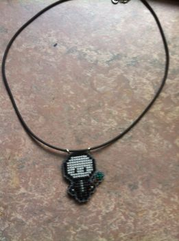 Voldemort cross stitched necklace by UnyieldingMadness