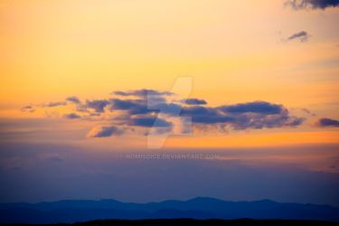 Silhouette of the Rocky Mountains Sunset by nomisdice