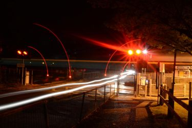 Nutbourne Level Crossing at night by HampshireBrony
