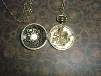 Dragon pocketwatch inside by CreativeChaotica