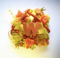 yellow and orange ''W'' initial brooch by RibbonsandClay
