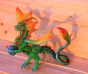 Spring dragon figurine with egg by FantasyIznakurnozh