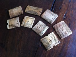 Medieval wooden combs by Dewfooter