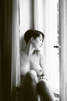 Woman at the window 2 by MrsHyde