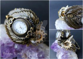 Steampunk watch with pearl and vintage gears by IkushIkush