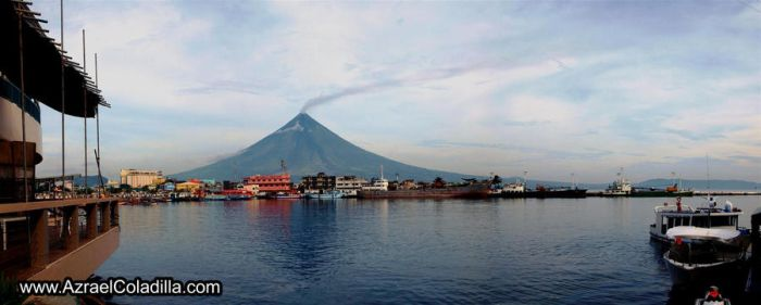 Mayon volcano view from city by popazrael