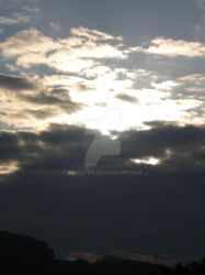 sun behind clouds by MichaFire